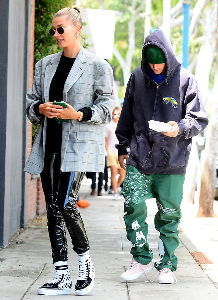 Justin Bieber wears pink Vans Authentic sneakers, while Hailey Baldwin opts for Vans Sk8-Hi Check shoes while leaving a spa in Beverly Hills on May 16, 2019