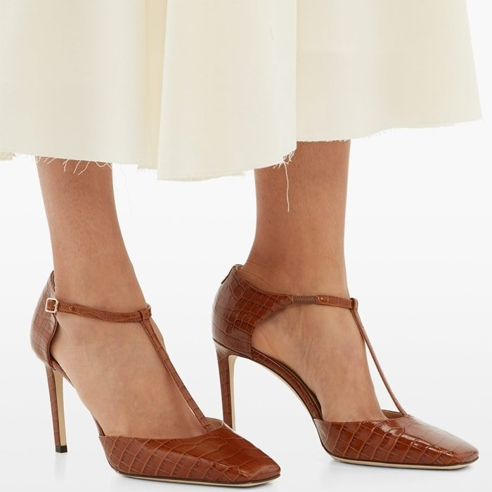 These flattering pumps are fashioned from high-shine crocodile-embossed leather in Italy with a slim stiletto heel and lined in beige leather