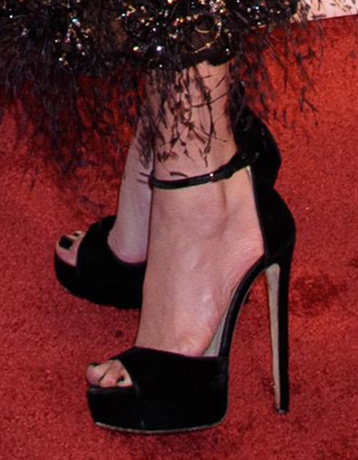 Jennifer Lopez slips her sexy feet into a pair of Jimmy Choo heels