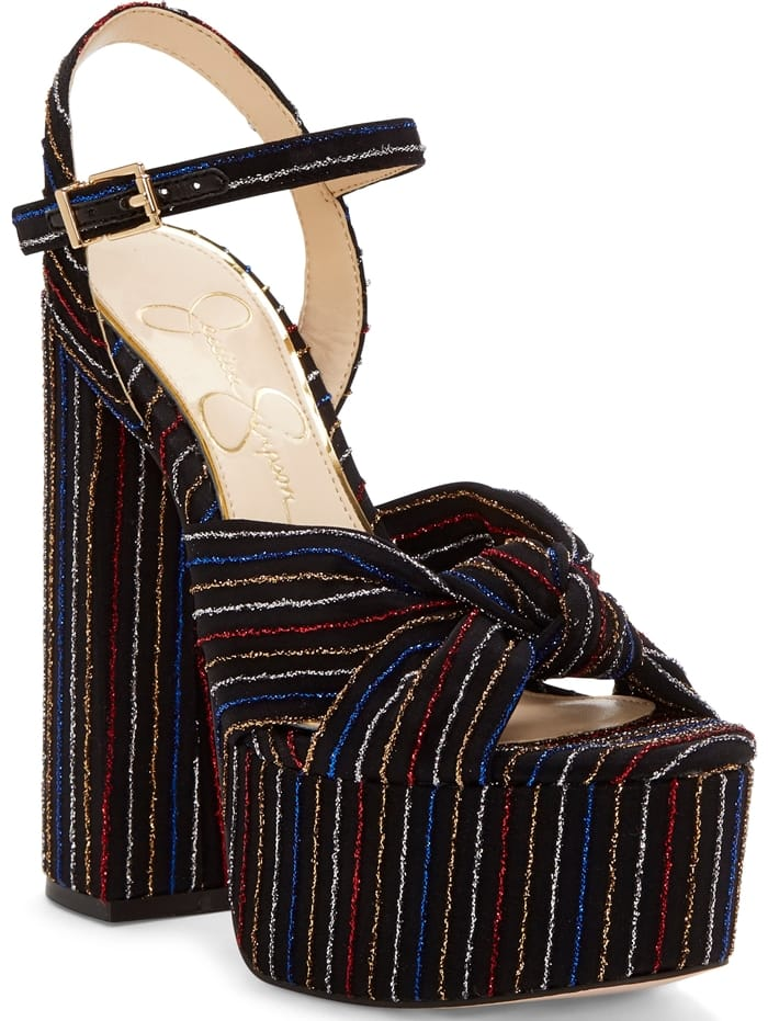 A superchunky heel and platform add to the drama of a quarter-strap sandal styled with knotted toe straps