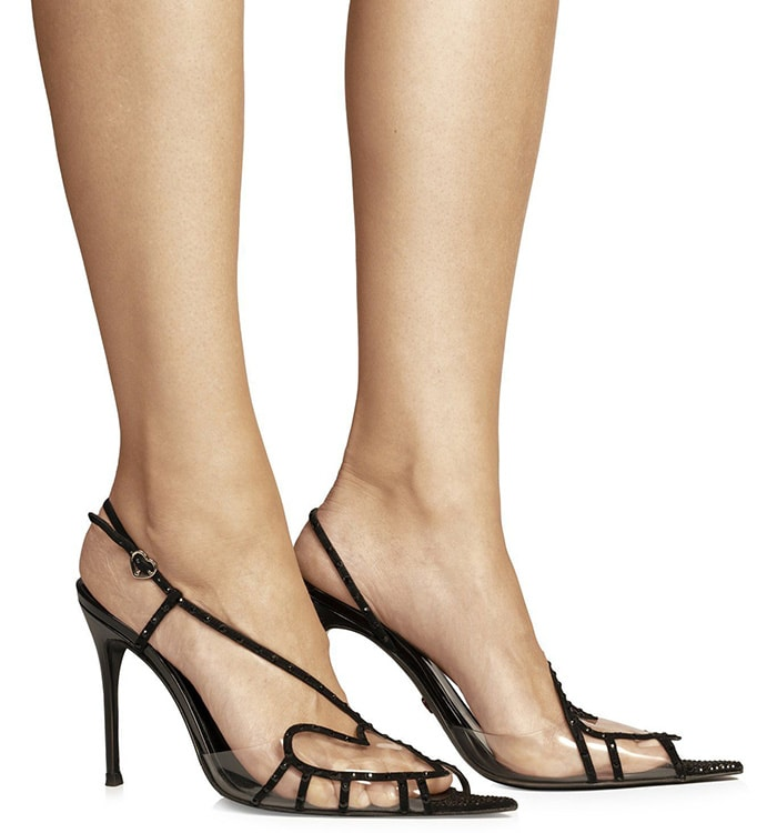 Juan Vidal takes on the slingback in strips of black fabric that form a ladylike heart at the top of the foot