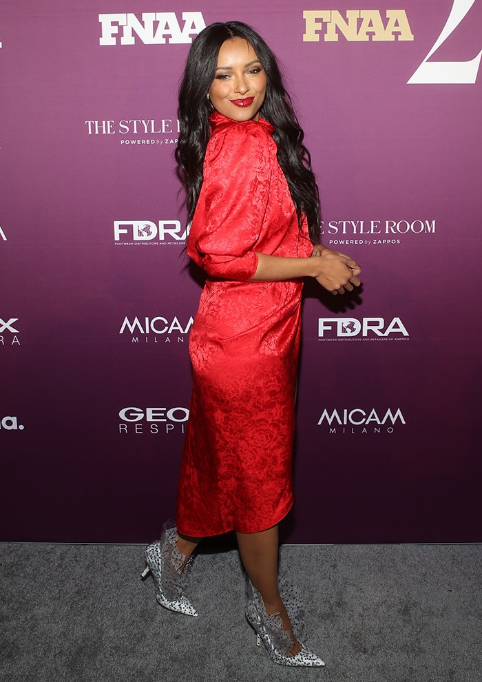Kat Graham stuns in a red floral brocade dress