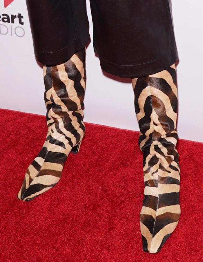 Katie Holmes wears the Khaite zebra-print slouch boots