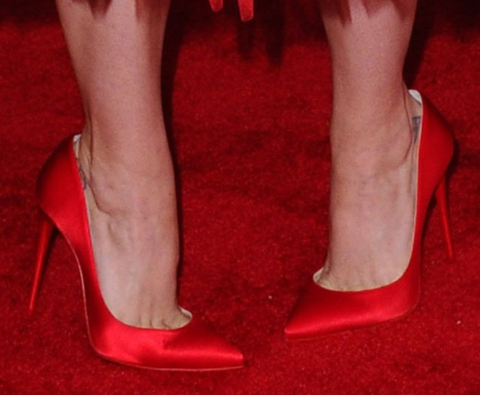 Katy Perry shows a hint of her foot tattoos in Christian Louboutin pumps
