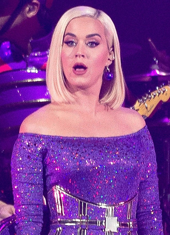Katy Perry wears matching purple eyeshadow and mauve lipstick