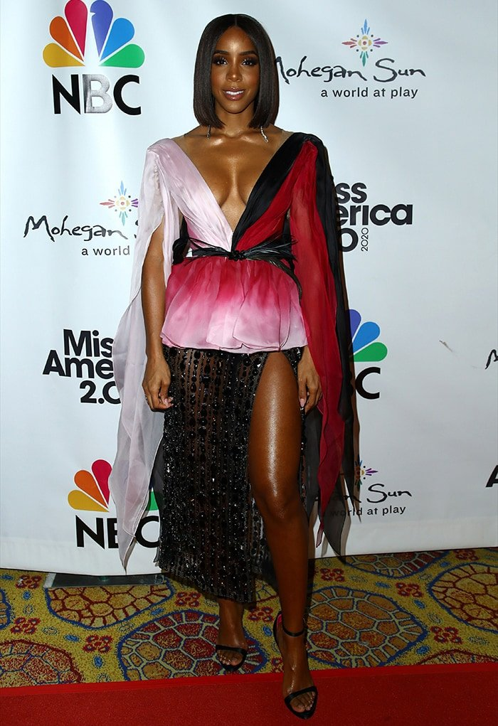 Kelly Rowland shows a hefty amount of cleavage and legs in Georges Hobeika dress