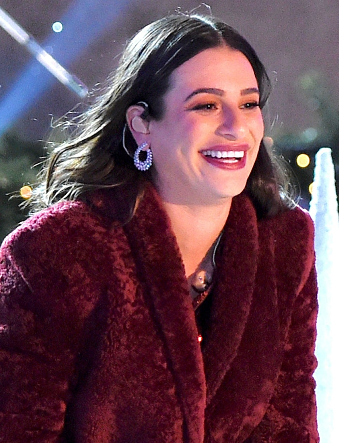Lea Michele all smiles while performing at the Rockefeller Center Christmas Tree Lighting event