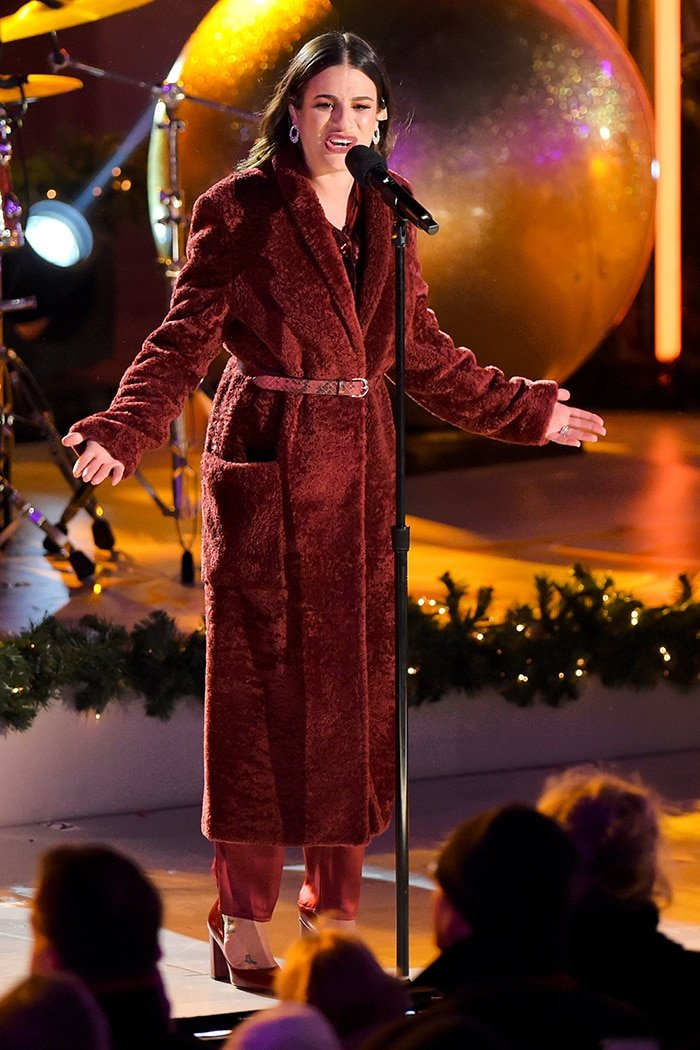 Lea Michele in Sally LaPointe oxblood outfit at the 87th Annual Rockefeller Center Christmas Tree Lighting Ceremony on December 4, 2019