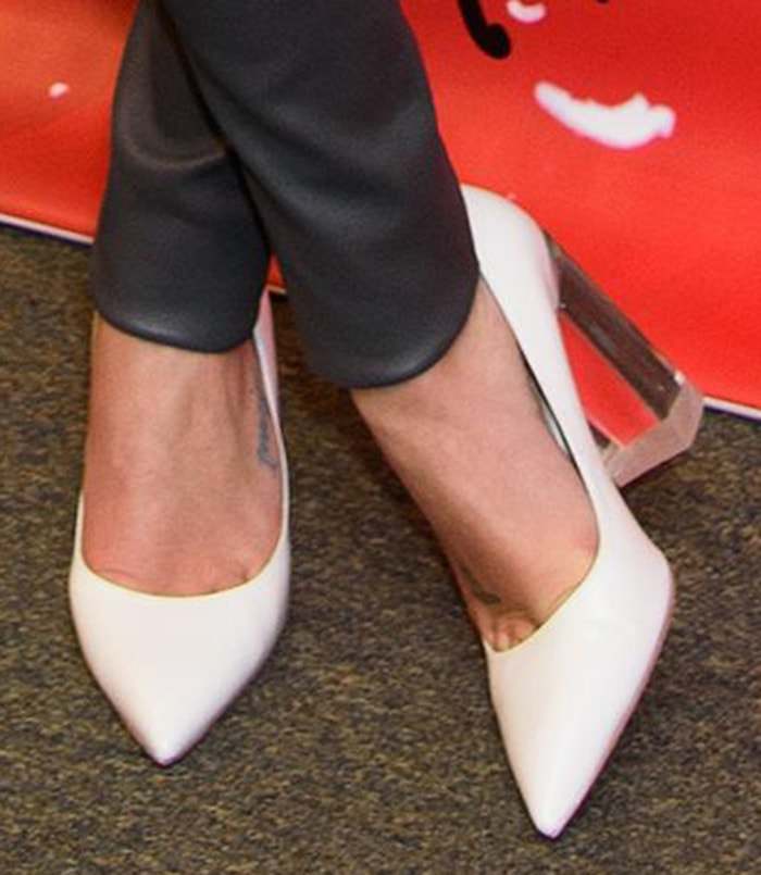 Lea Michele slips into a pair of Stuart Weitzman pumps with clear lucite block heels