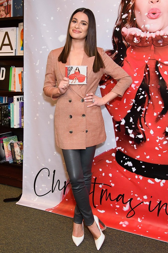 Lea Michele launches her holiday album in Zeynep Arcay blazer and leather pants at Barnes & Noble on December 5, 2019