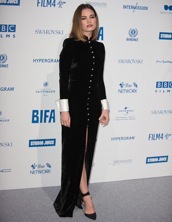 Lily James shows off her slender legs in Alessandra Rich black velvet dress