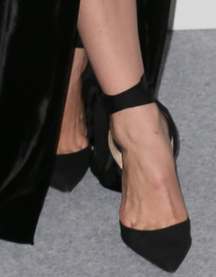 Lily James shows off her feet in Christian Louboutin ankle-tie pumps