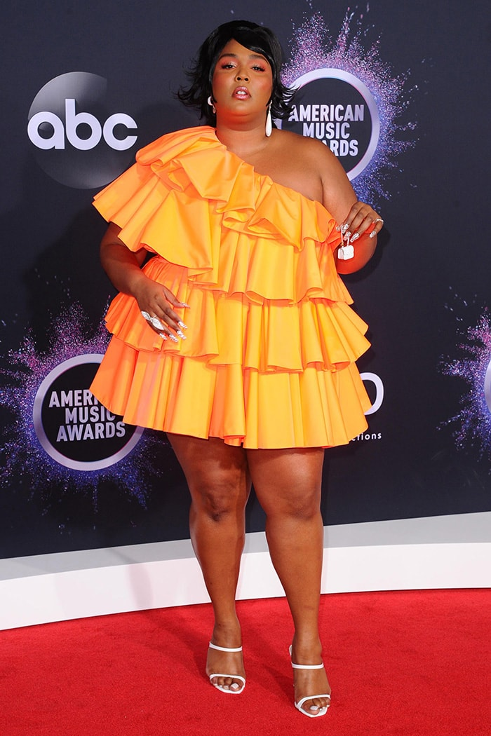 Lizzo attends the 2019 AMAs in Maison Valentino mini dress on November 24, 2019