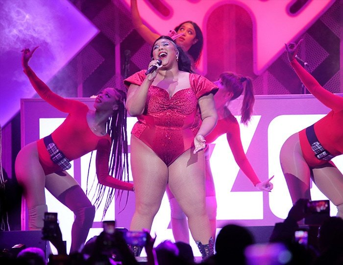Lizzo performs in a red embellished bodysuit at the 2019 Jingle Ball Concert in Philadelphia on December 11, 2019