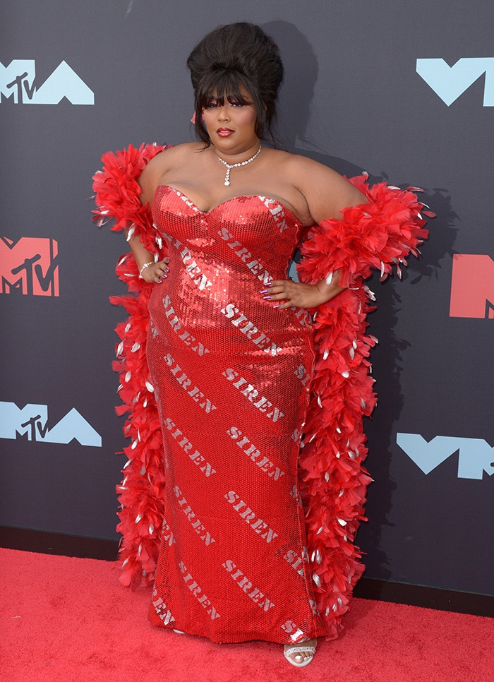 Lizzo in a custom red Moschino by Jeremy Scott sequin gown at the 2019 MTV VMAs on August 26, 2019