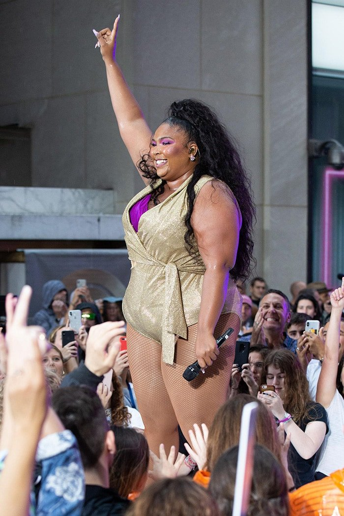 Lizzo shows off her legs in a glittery gold bodysuit while performing on NBC's Today Show on August 23, 2019