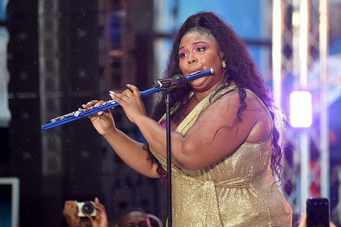 Lizzo plays the flute while performing on NBC Today Show on August 23, 2019
