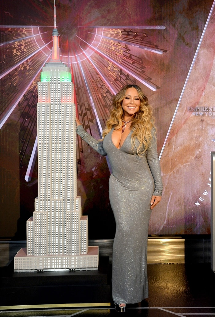 """Mariah Carey participates in the ceremonial lighting of the Empire State Building to commemorate the 25th anniversary of the release of her single """"All I Want For Christmas Is You"""""""