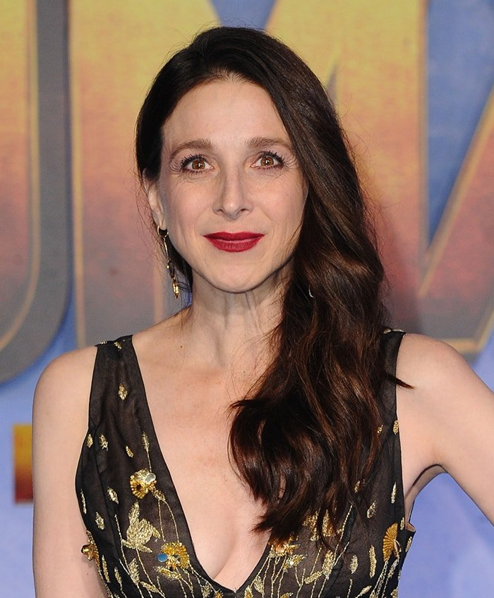 Marin Hinkle styles her tresses in loose waves and wears red lipstick