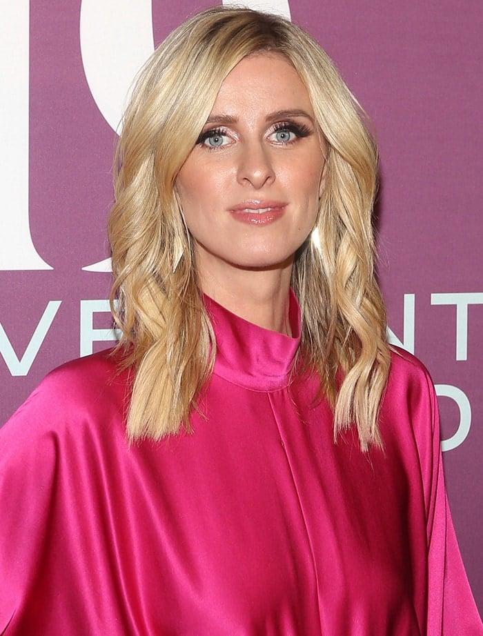 Nicky Hilton wears her blonde locks in loose curls with metallic smoky eyeshadow