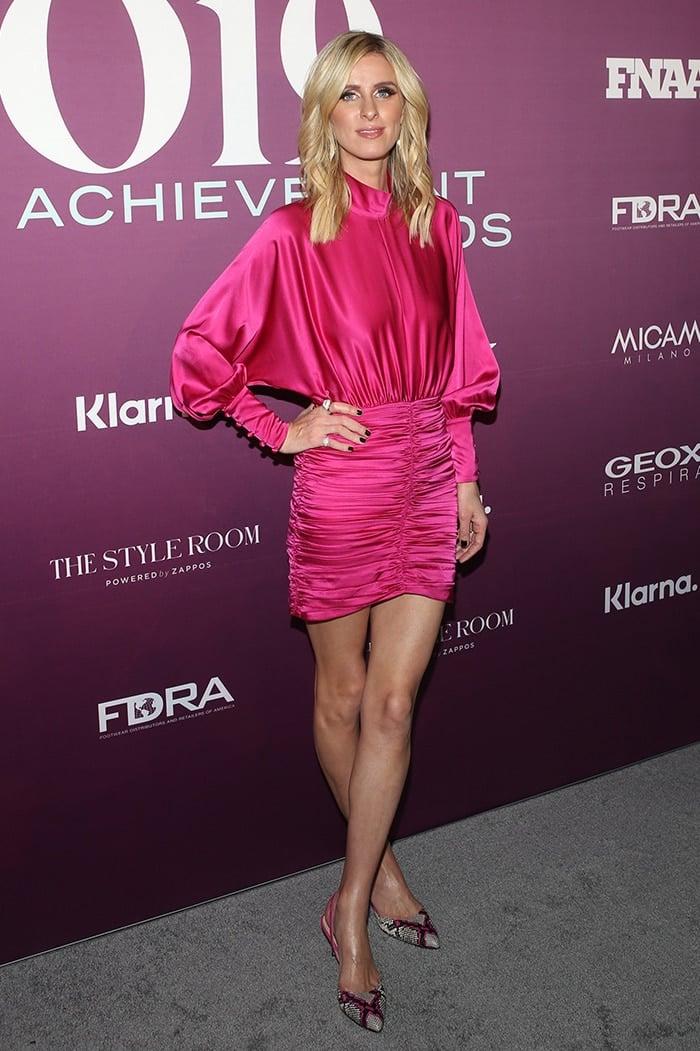 Nicky Hilton displays her legs in pink satin mini dress