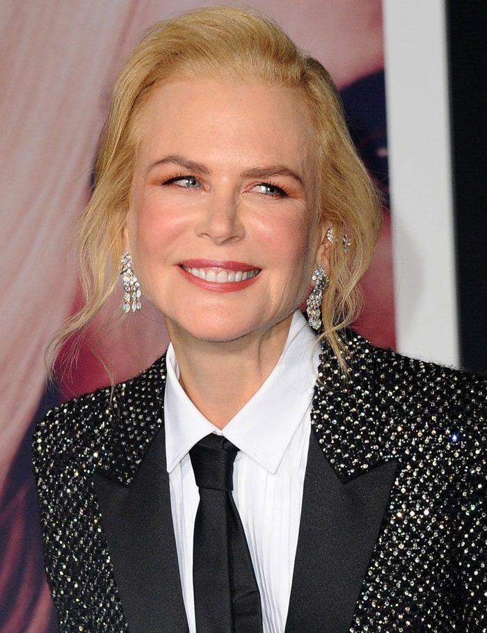 Nicole Kidman wore a black shimmery blazer over a white button-down top