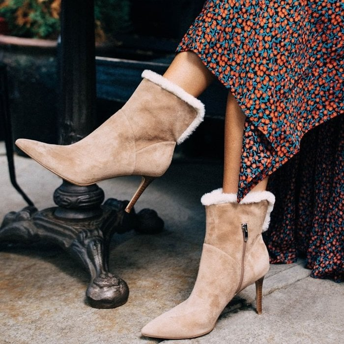 Tailored shapes with toasty faux-fur trim, Nine West's Fhani dress booties finish an outfit with finesse