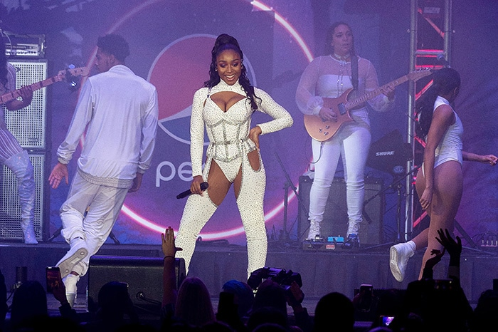 Normani wears the same white embellished bodysuit with matching chaps at 2019 B96 Pepsi Jingle Bash at the Allstate Arena in Chicago on December 8, 2019