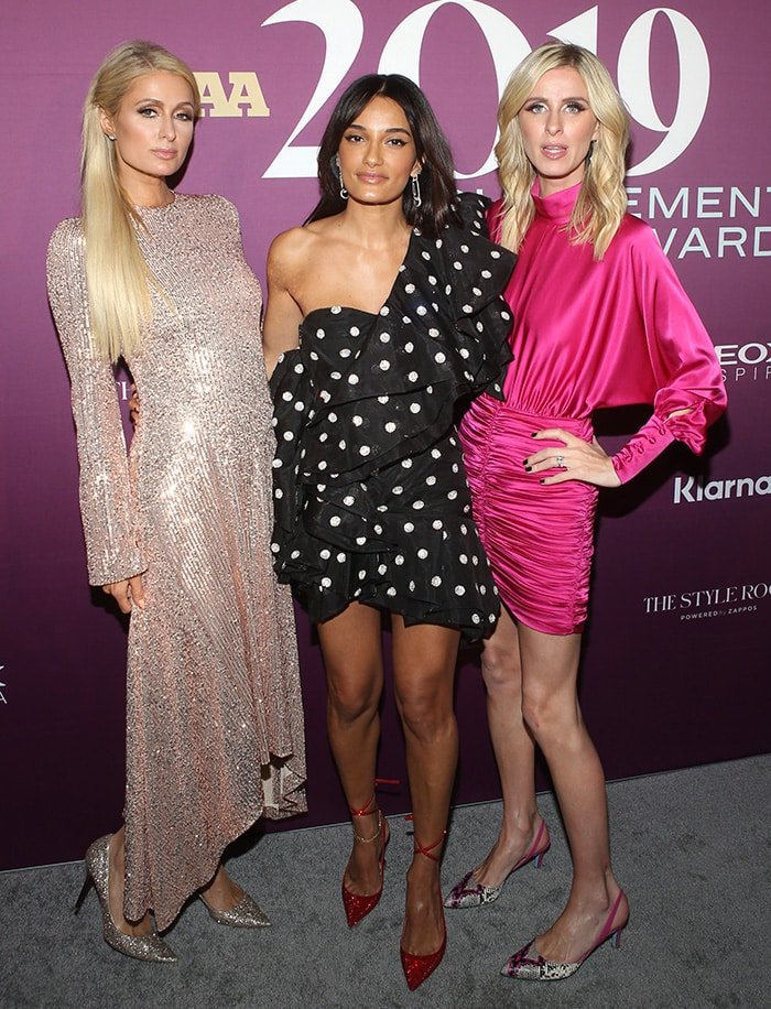 Paris Hilton, Amina Muaddi, and Nicky Hilton at the 33rd Annual Footwear News Achievement Awards held at IAC Building in New York City on December 3, 2019