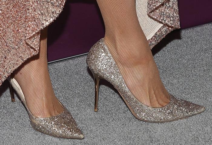 Paris Hilton wears fishnets with Jimmy Choo pumps