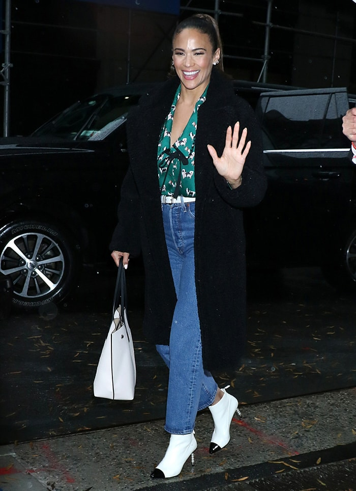Paula Patton in green dog patterned top, denim jeans, and Chanel boots outside the Buzzfeed office in New York City on December 17, 2019
