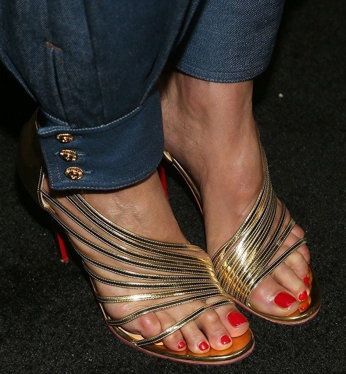Paula Patton displays her hot feet in Christian Louboutin strappy gold sandals