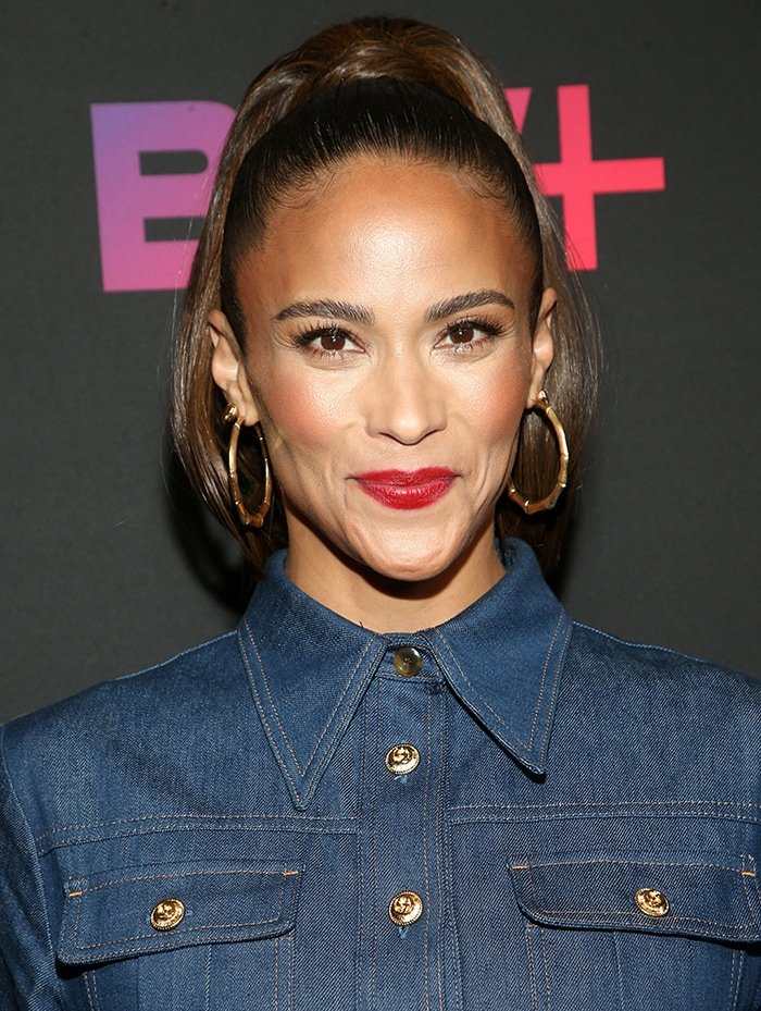 Paula Patton pulls her hair back into a ponytail