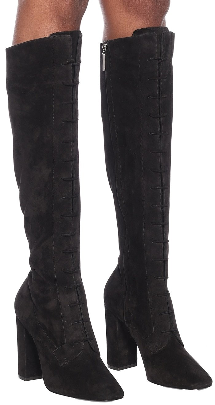 Sensual and striking, the black suede Laura boots from Saint Laurent tap into the label's confident styling
