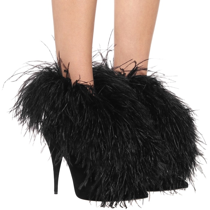 Crafted in Italy from suede, this point-toe silhouette is embellished with a string of feathers that protrude from the tops to drape down over the feet