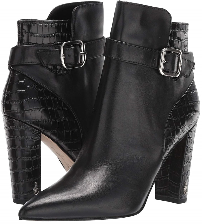 Logo hardware sets off the wrapped half-moon heel and strap of a Sam Edelman bootie with a pointy-toe silhouette and plenty of versatility