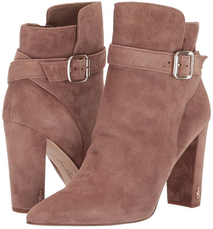 Logo hardware sets off the wrapped half-moon heel and strap of a chic Sam Edelman bootie with a pointy-toe silhouette and plenty of versatility