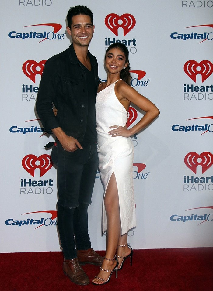 Sarah Hyland looks radiant in Manning Cartell dress and Sophia Webster heels while posing with Wells Adams