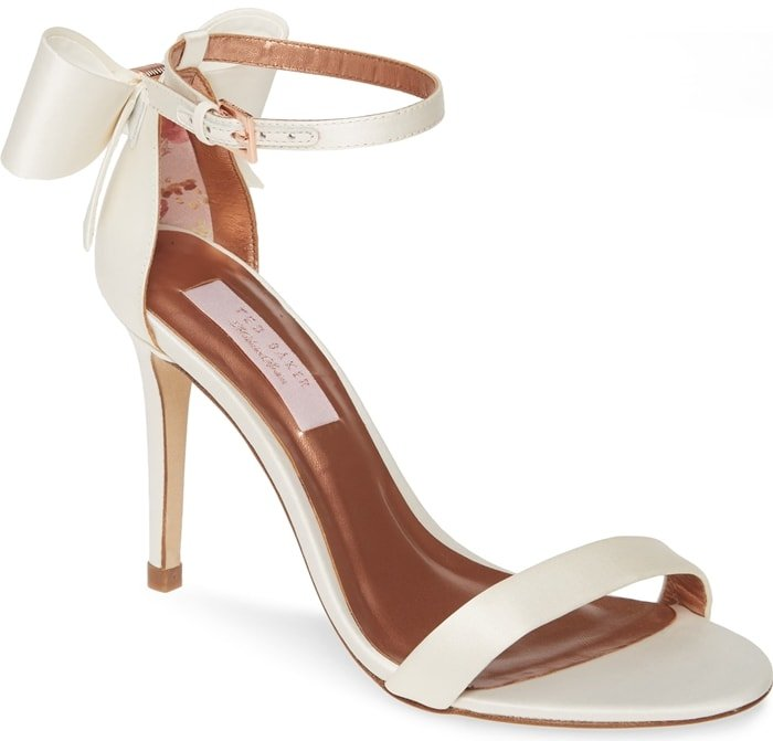 A signature bow provides a picture-perfect finishing touch for a satin sandal topped by a slim ankle strap