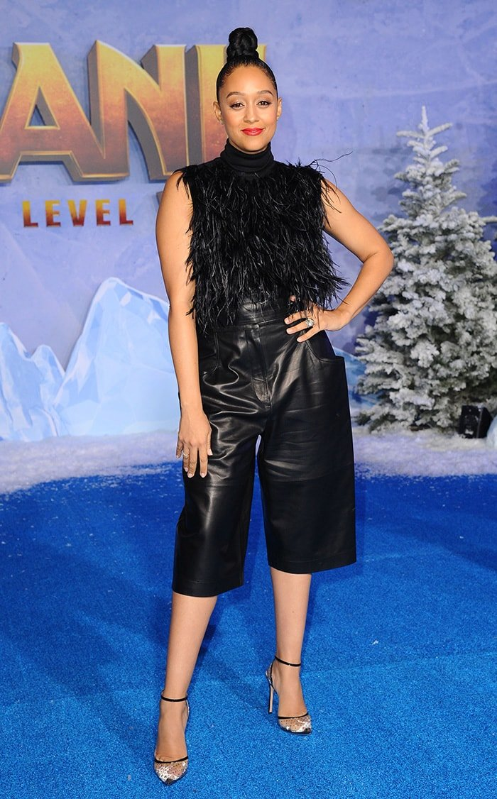 Tia Mowry teams a Giambattista Valli feathered top with Proenza Schouler leather culottes