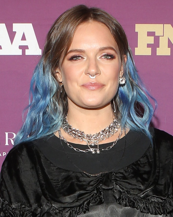 Tove Lo flaunts her septum ring and wears her dip dye blue hair in loose waves