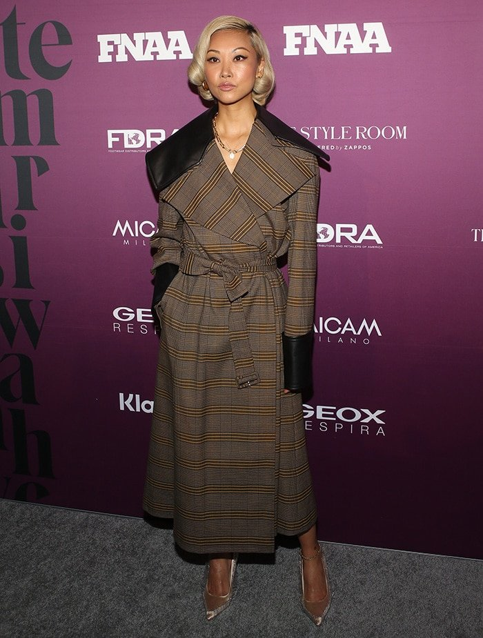 Vanessa Hong looks chic in a leather-trimmed plaid trench coat