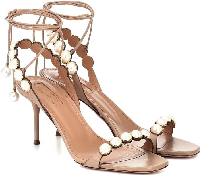 Slingback leather sandals finished with a delicate lace-up ankle strap are trimmed with glossy faux pearls