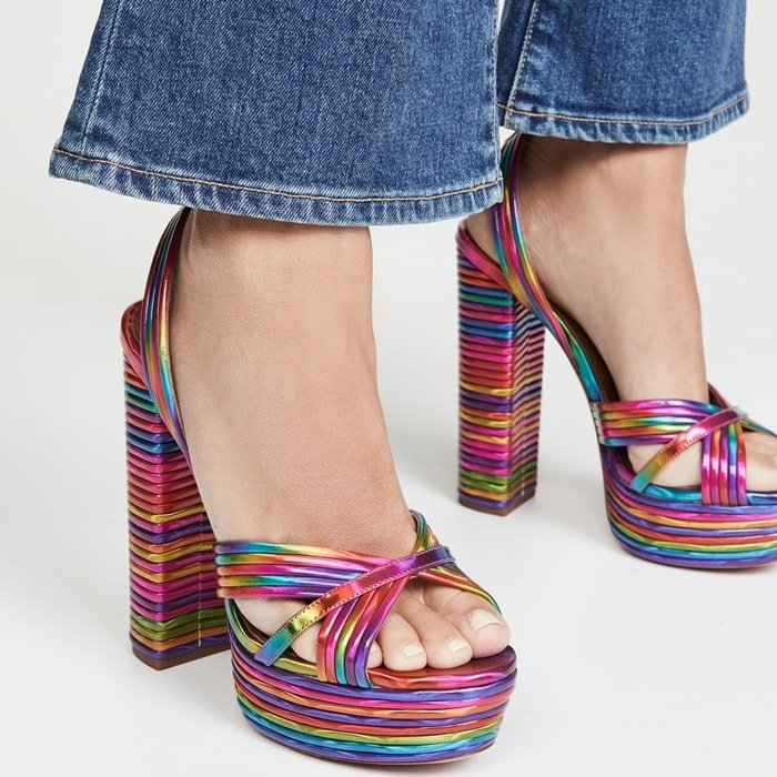 In a whimsical ombré-style rainbow finish, these sky-high platform sandals exude 70s-inspired charm