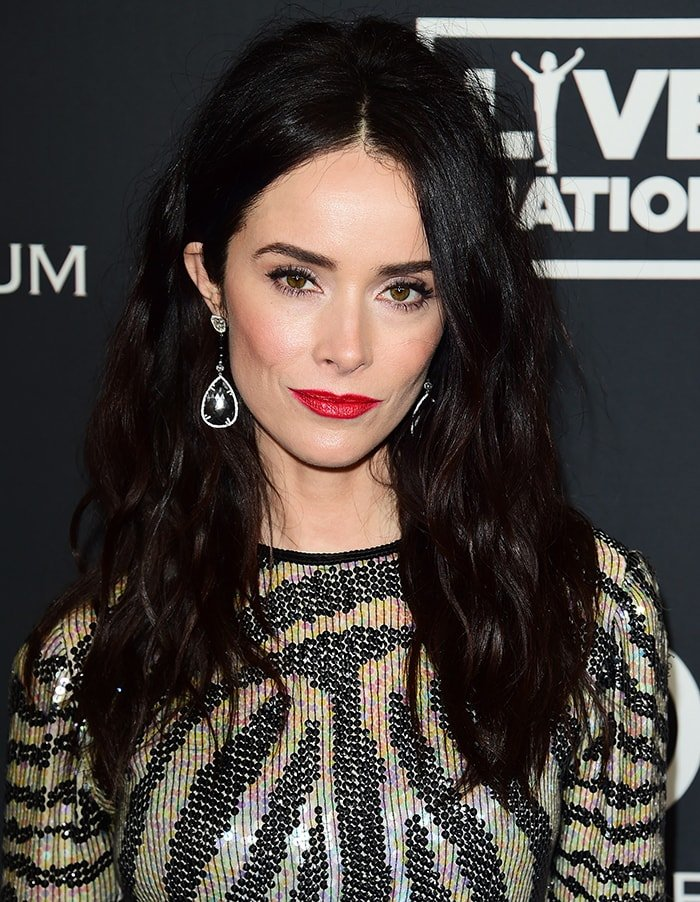 Abigail Spencer amps up her fierce look with tousled waves and red lipstick