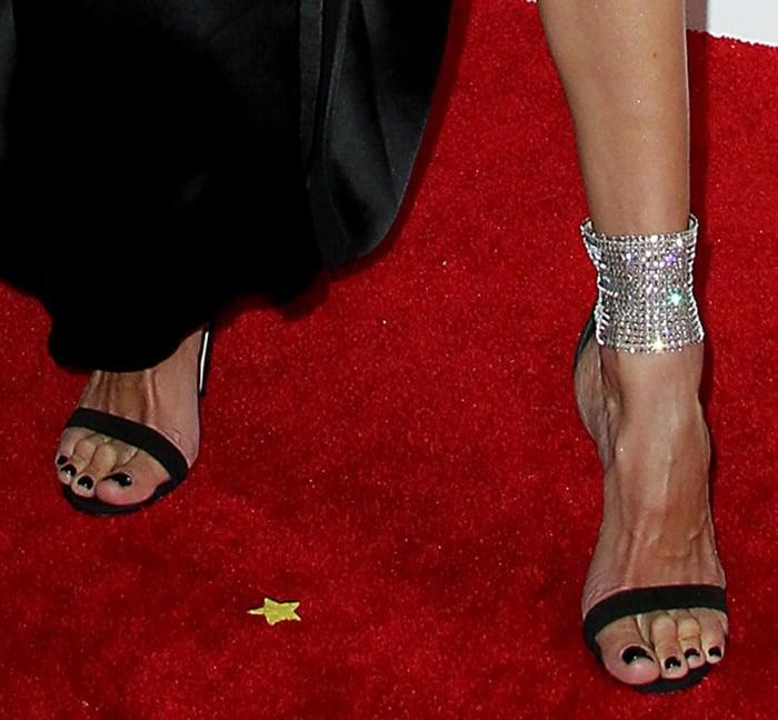 Alessandra Ambrosio slips her pedicured feet in Gianvito Rossi heels
