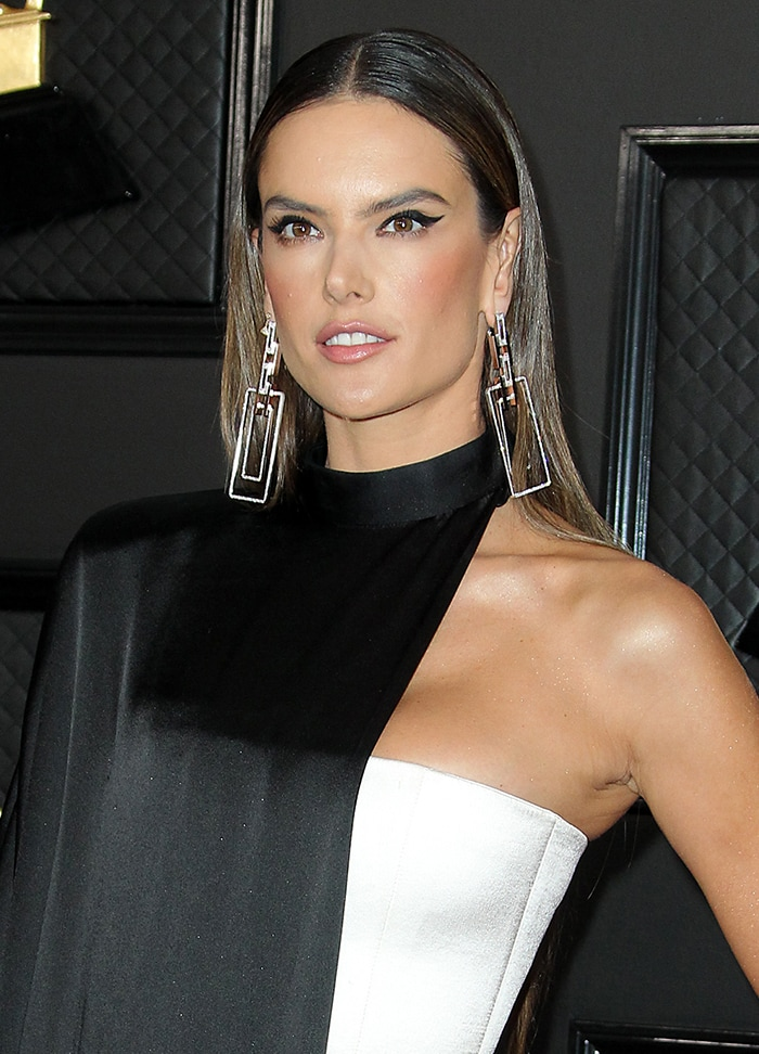 Alessandra Ambrosio wears sleek straightened hairstyle with winged eyeliner and nude pink lipgloss