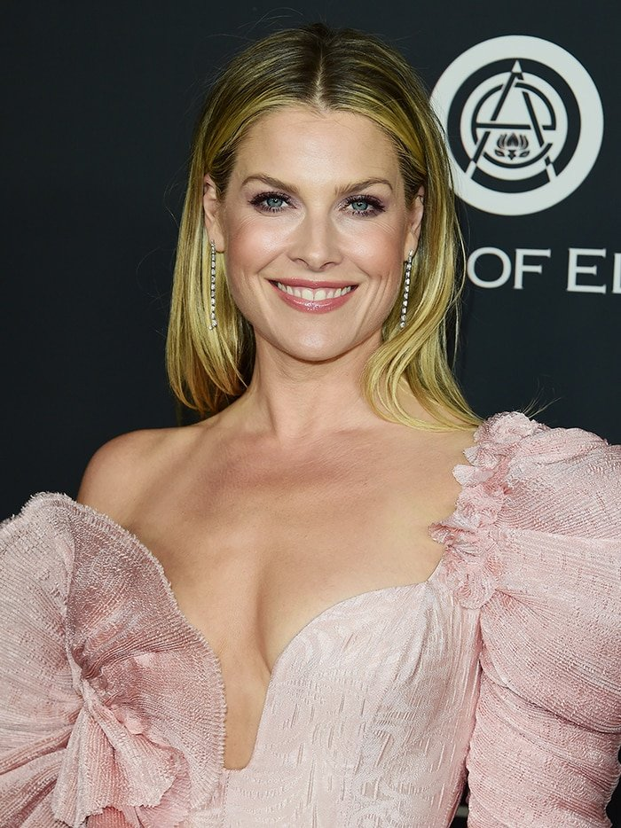 Ali Larter complements her dress with pink lipstick and glittery purple eyeshadow