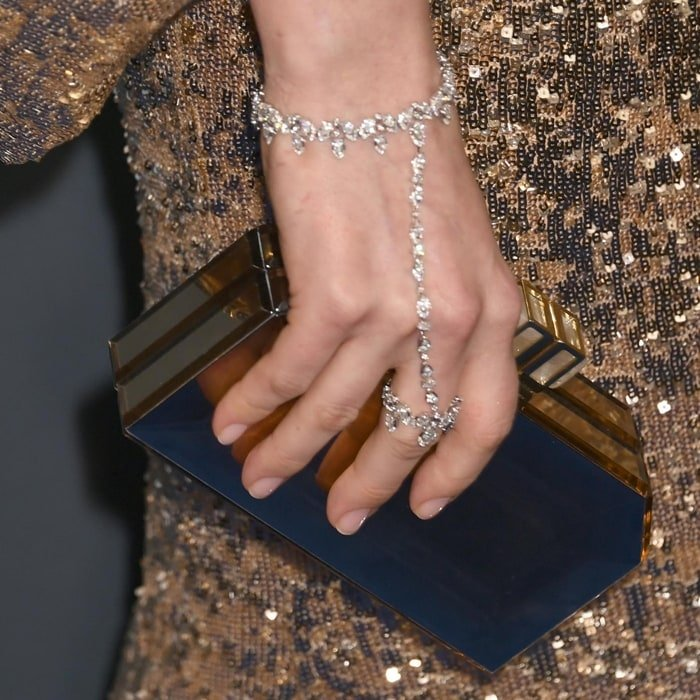 Anne Hathaway' wore a Desert Bloom diamond hand bracelet from Messika Jewelry