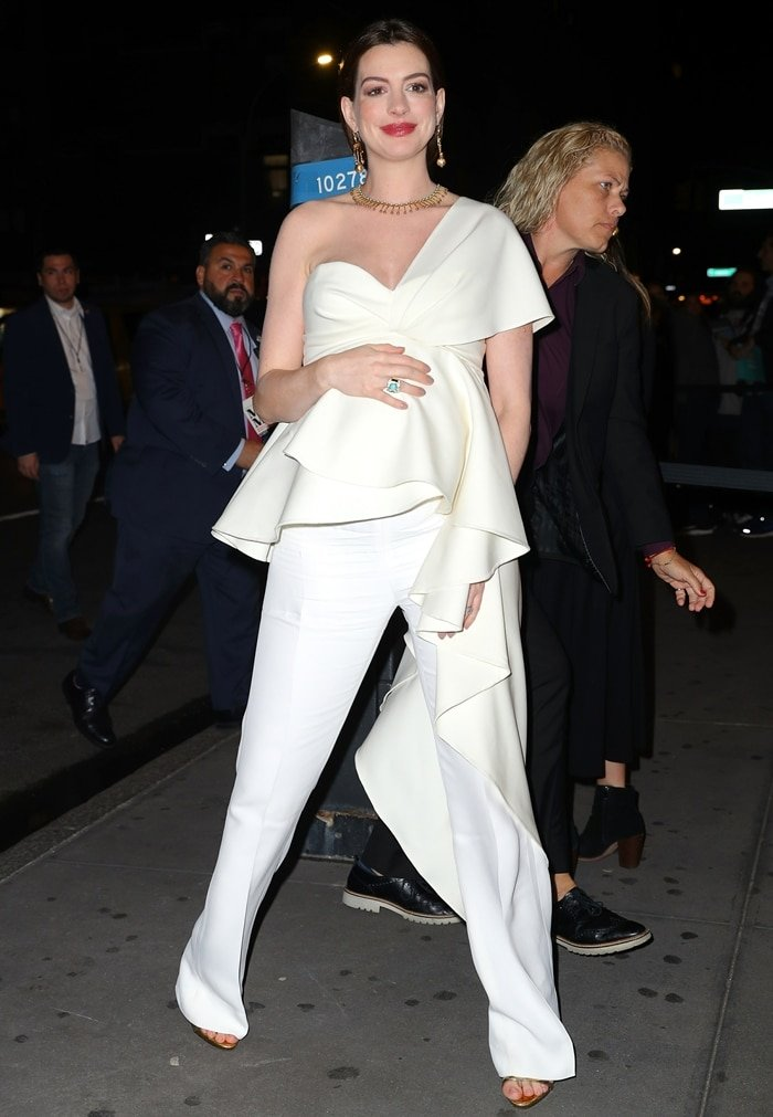 Anne Hathaway outside the Museum of Modern Love grand opening event